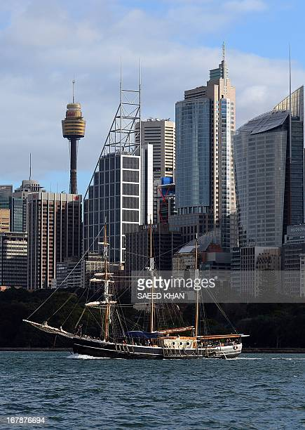 A boat sails in front of the skyline in Sydney on May 2 2013 According to a report the number of Australian home building permits fell sharply in...