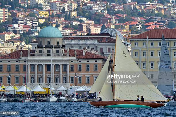 A boat sails in Trieste's harbour on October 11 2014 on the eve of the Barcolana regatta More than 1800 boats will take part in the 46th Barcolana on...