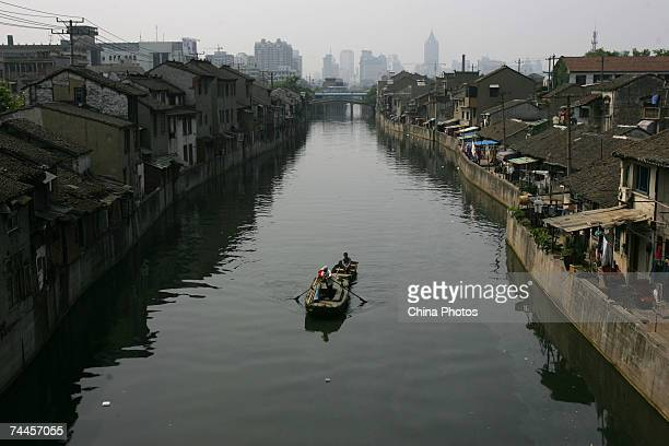A boat sails on the ancient Jinghang Canal on June 8 2007 in Wuxi of Jiangsu Province China The Qingming Bridge has a history of about 400 years It...