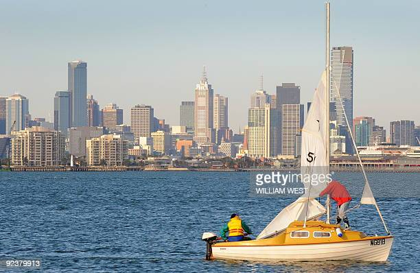 A boat sails past the Melbourne skyline on October 27 2009 as an offical report has warned that Australia may have to force people to evacuate...