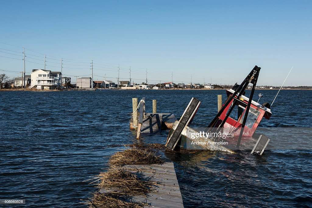 A boat sinks off a dock near Stone Harbor Boulevard after a blizzard hit the region on January 24 2016 in Middle Township New Jersey A major...