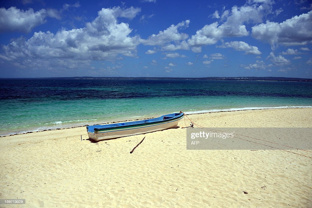 A boat sits on a beach on January 9, 2013 in Zanzibar.