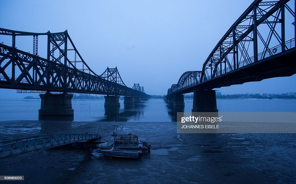 A boat sits on the banks of the Yalu River in the Chinese border town of Dandong, opposite to the North Korean town of Sinuiju, on February 8, 2016. The UN Security Council strongly condemned North Korea's rocket launch on February 7 and agreed to move quickly to impose new sanctions that will punish Pyongyang for 'these dangerous and serious violations.' With backing from China, Pyongyang's ally, the council again called for 'significant measures' during an emergency meeting held after North Korea said it had put a satellite into orbit with a rocket launch. AFP PHOTO / JOHANNES EISELE / AFP / JOHANNES EISELE