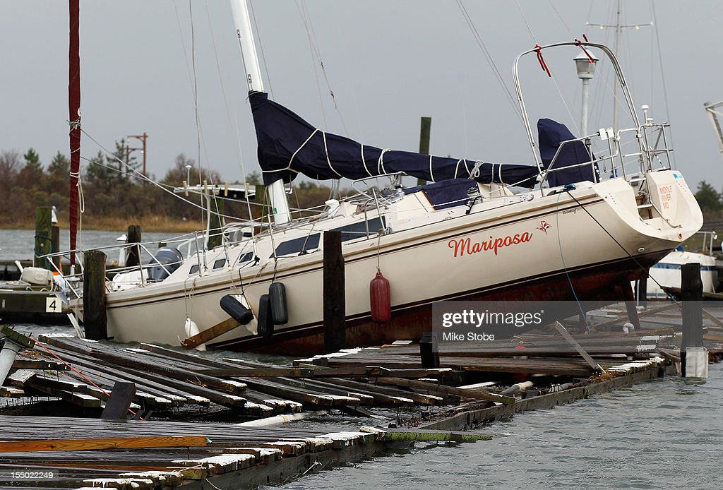 A boat sits on the dock at the East Marina in Point Lookout on October 30 2012 in Long Beach New York The storm has claimed at least 40 lives in the...