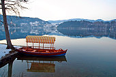 A boat sits still on Lake Bled, Slovenia.