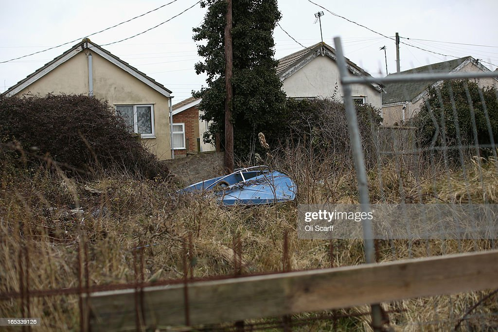 A boat stands in an overgrown garden in front of dilapidated properties in the seaside town of East Jaywick, the most deprived place in England, on April 3, 2013 in Jaywick, England. The Government's 2011 Indices of Multiple Deprivation' measure ranks Jaywick as the most deprived of all 32,482 small wards in England and Wales. The area also has the greatest number of young people not in employment, education or training; one third of 16 to 24 year-olds claim Jobseeker's Allowance, compared to the national average of 6 per cent. Changes to the benefits and tax system which came into force on April 1, 2013 have included a cut in housing benefit payments for working-age social housing tenants whose property is deemed larger than they need and council tax support payments now being administered locally.