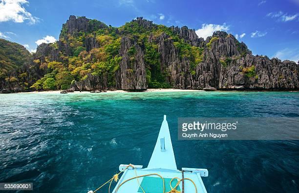 Boat towards tropical island in El Nido, Palawan