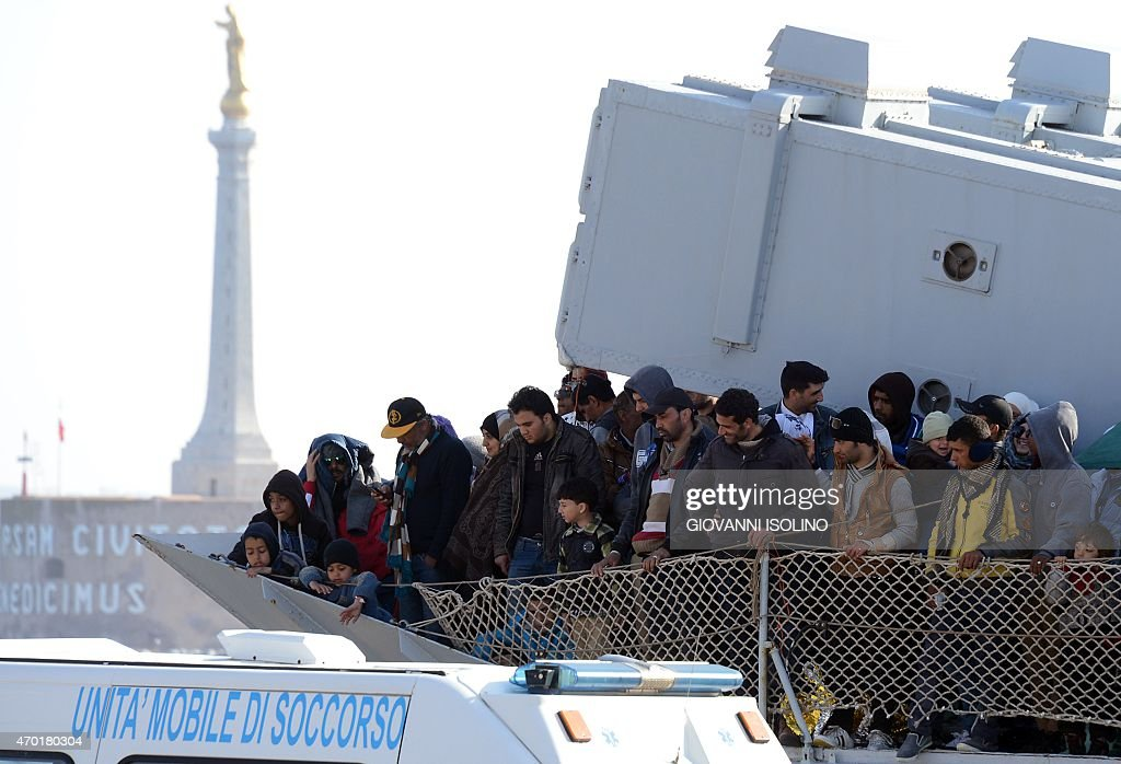 A boat transporting migrants arrives in the port of Messina after a rescue operation at see on April 18 2015 in Sicily A surge of migrants pouring...