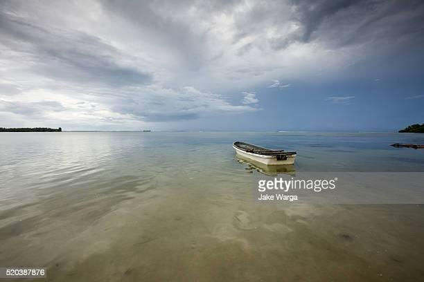 Boat under stormy sky, Kavieng, Papua New Guinea