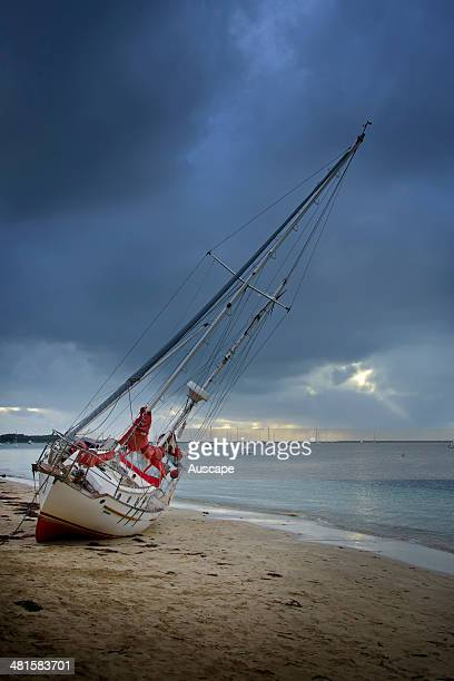 Boat washed ashore after breaking its moorings during wild weather Rockingham Western Australia
