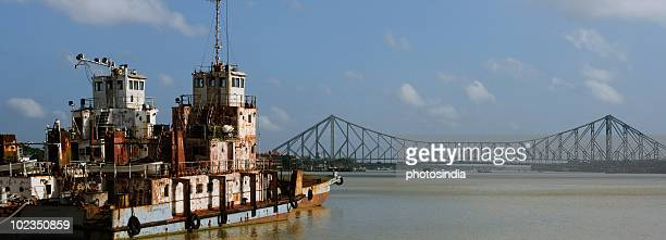 Boat with a bridge in the background, Howrah Bridge, Hooghly River, Kolkata, West Bengal, India