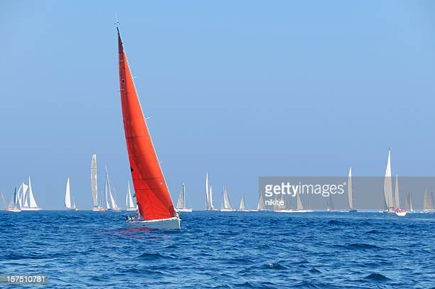 Boat with a red sail during the sailin competition
