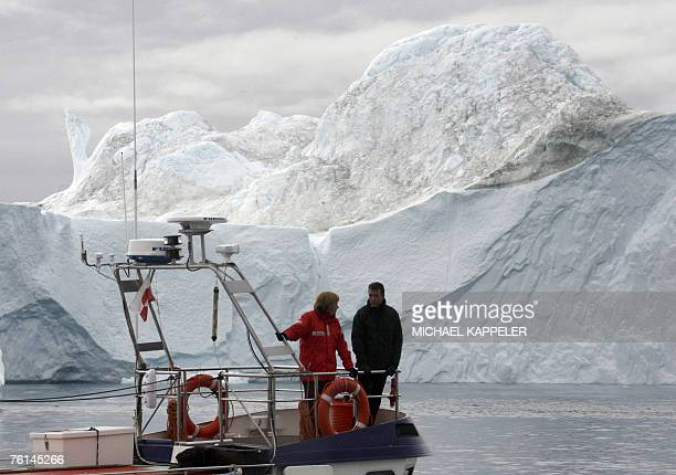 A boat with German Chancellor Angela Merkel and Denmark's Prime Minister Anders Fogh Rasmussen onboard navigates through a fjord near Ilulissat in...