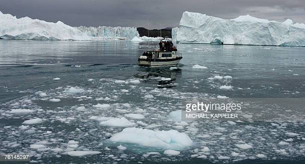 A boat with German Chancellor Angela Merkel German Environment Minister Sigmar Gabriel Denmark's Prime Minister Anders Fogh Rasmussen Denmark's...
