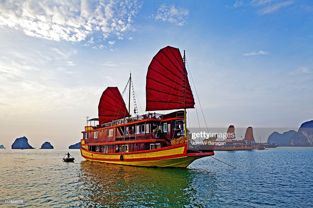 Boat with red sails Halong Bay : Stock Photo