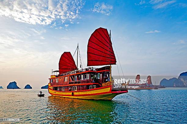 Boat with red sails Halong Bay