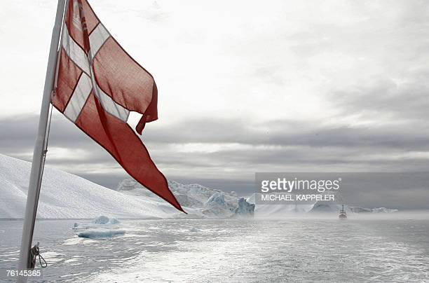 A boat with the Danish flag navigates through a fjord near Ilulissat in Greenland 16 August 2007 German Chancellor Angela Merkel and German...
