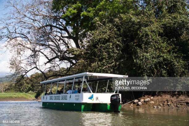 A boat with tourists navigates along the Grande River in Tarcoles 110 km southwest of San Jose on February 15 2017 The up to sevenmeterlong...