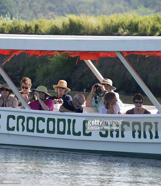 A boat with tourists navigates along the Río Grande in Tarcoles 110 km southwest of San Jose taking them to see the different types of birds and...