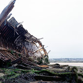Boat wreck on river coast
