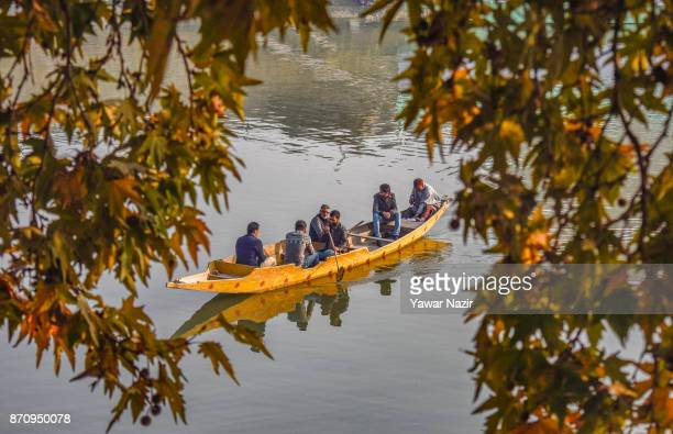 A boatman ferries people in his boat on November 06 2017 in Srinagar the summer capital of Indian administered Kashmir India Markets in the Kashmir...