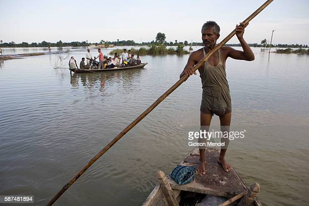 Boatman Harendra Sahni punts through flooded farmland near the village of Madhubani Ghat in east Champaran This is in the province of Bihar which was...