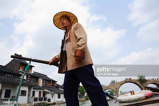 Boatman on tourist boat.