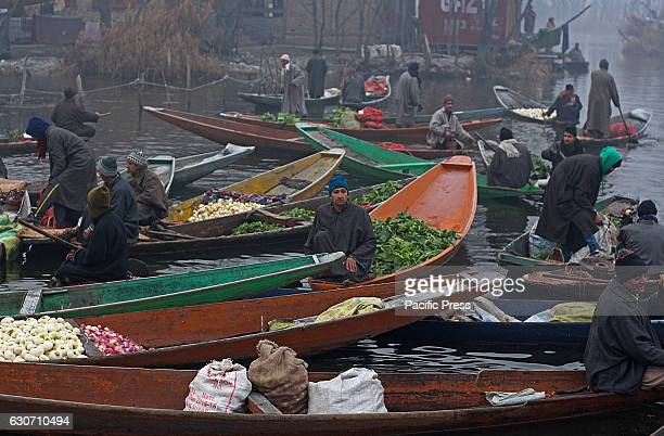 Boatmen sell vegetables at the floating vegetable market in the interiors of famed Dal Lake in Srinagar the summer capital of Indian controlled...