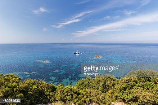 boats among the coral sea : Stock Photo