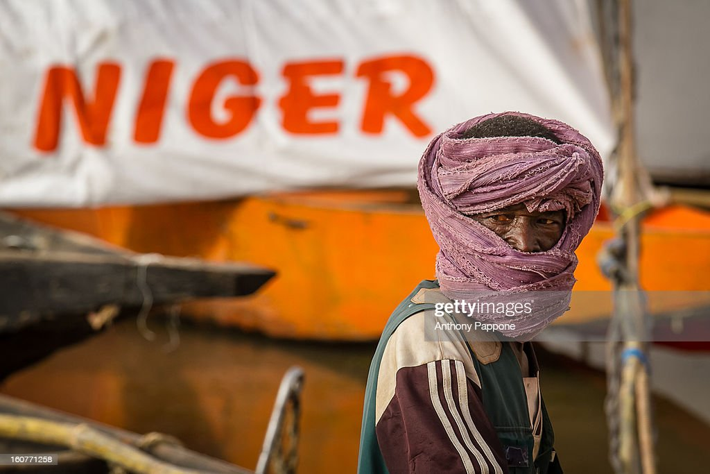 CONTENT] boats and a man with the turban at the port on the River Niger in Segou, mali, sahel