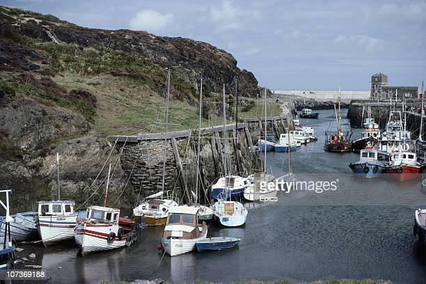 Boats and fishing vessels moored in the harbour of Amlwch which is in the north coast of the Isle Of Anglesey Wales September 1982
