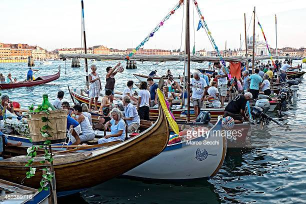 Boats and party goers gather in St Mark's Basin and Giudecca Canal on the day of the Redentore Celebration on July 19 2014 in Venice Italy Redentore...