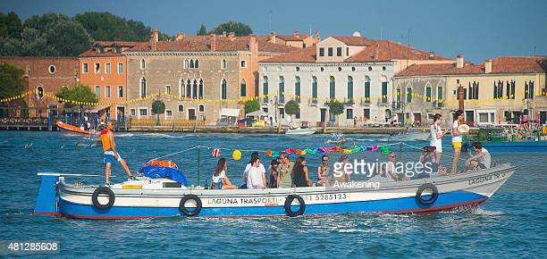 Boats and party goers gather in St Mark's Basin and Giudecca Canal on the day of the Redentore Celebration on July 18 2015 in Venice Italy Redentore...