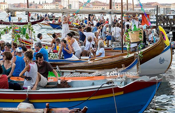 Boats and party goers gather in St Mark's Basin on the day of the Redentore Celebration on July 19 2014 in Venice Italy Redentore which is in...