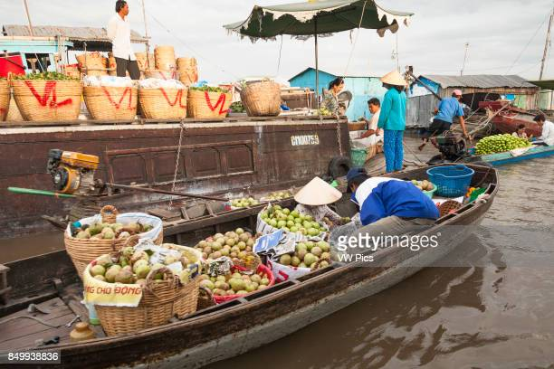 Boats and people in the floating market Cai Rang near Can Tho Mekong River Delta Vietnam
