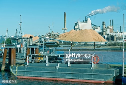 Boats and pulp mill on industrial waterway in Tacoma WA : Stock Photo