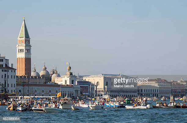 Boats and revellers start to gather in St Mark's Basin on the day of the Redentore Celebration on July 19 2014 in Venice Italy Redentore which is in...
