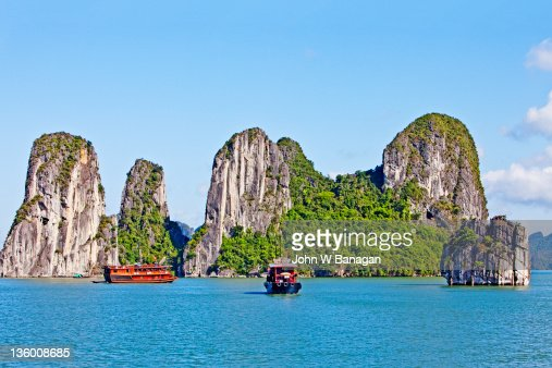 Boats and Rock formations , Ha long Bay : Stock Photo