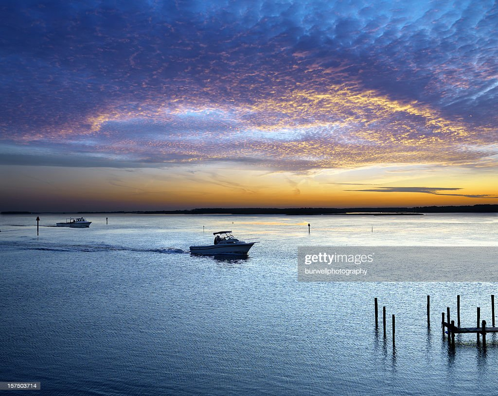 Boats and sunset on the water