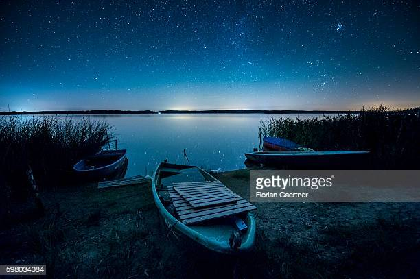 Boats are captured in front of the starry sky at the reservoir of Quitzdorf on August 31 2016 in Diehsa Germany