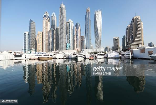 Boats are docked at the Dubai International Marine Club during the Gulf emirate's international Boat Show on February 28 2017 / AFP / KARIM SAHIB