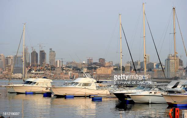 Boats are docked in a marina with Luanda's skyline behind on August 30 2012 The ruling Popular Movement for the Liberation of Angola party of...