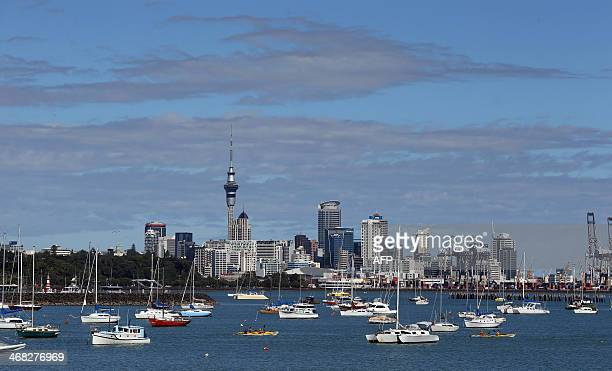 Boats are moored in waters in front of the Auckland city skyline New Zealand on February 10 2014 New Zealand's central bank left the official cash...