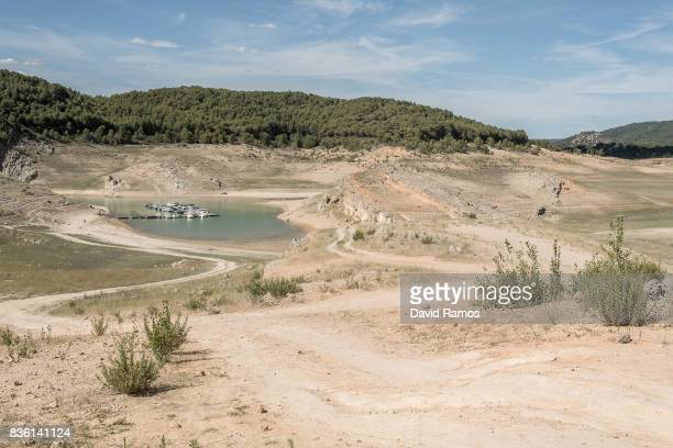 Boats are moored on a shrinking arm of the second largest water reservoir feeding the Segura River and Spain's Southeastern regions which is at 12%...