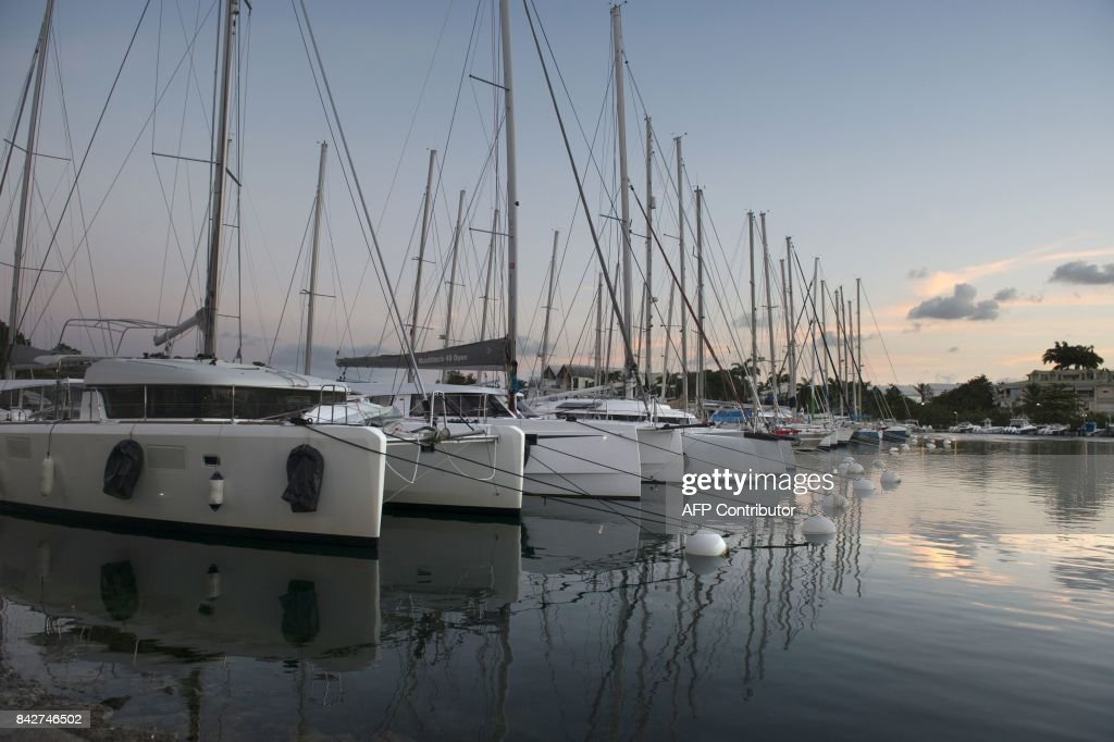 Boats are moored on September 4, 2017 at the harbour in Pointe-a-Pitre, on the French overseas island of Guadeloupe, prior to the arrival of Hurricane Irma. / AFP PHOTO / Helene Valenzuela