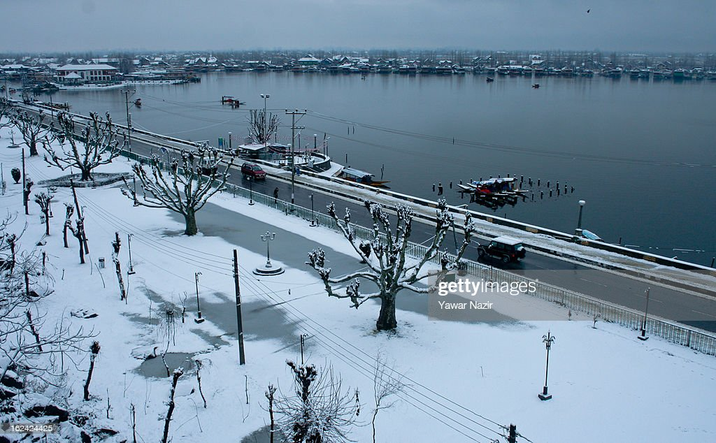 Boats are moored to the bank of Dal lake after a snowfall on February 23, 2013 in Srinagar, Indian Administered Kashmir, India. Several parts of the Kashmir Valley, including the summer capital Srinagar, experienced fresh snowfall today, prompting the authorities to issue an avalanche warning and leading to closure of the Jammu-Srinagar Highway, the only road link between Kashmir and rest of India.
