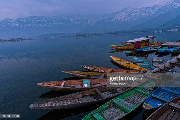 Boats are moored to the bank of Dal Lake on December 14 2015 in Srinagar the summer capital of Indian administered Kashmir India Kashmir the Muslim...