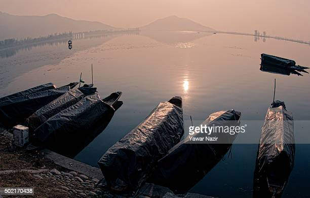 Boats are moored to the bank of Dal lake on December 21 2015 in Srinagar the summer capital of Indian administered Kashmir India Kashmir the Muslim...