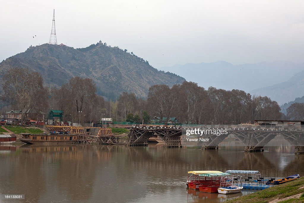 Boats are moored to the bank of the river Jehlum on March 20, 2013 in Srinagar the summer capital of Indian administered Kashmir, India. Kashmir has been a contested land between nuclear neighbors India and Pakistan since 1947, the year both the countries attained freedom from the British. Since 1947 the ownership of Kashmir has been disputed between Pakistan, India and China.