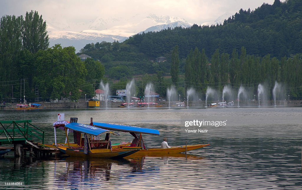 Boats are moored to the jetty in Dal Lake on May 14, 2012 in Srinagar, India. Dal Lake has a total area of 29 square kilometres and is home to thousands of Shikaras and houseboats.